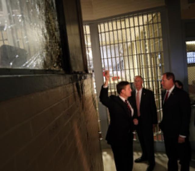 holman-gov-tour-1-shattered-window